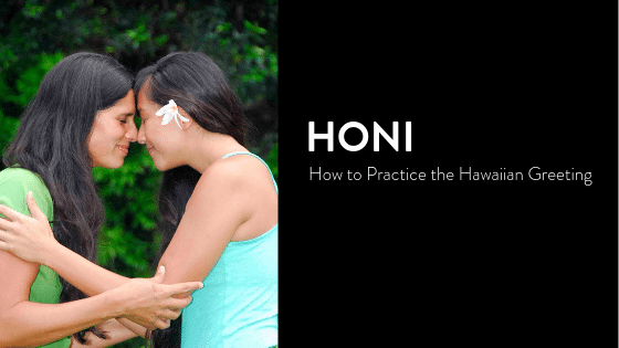Two women giving Honi, the traditional Hawaiian Greeting